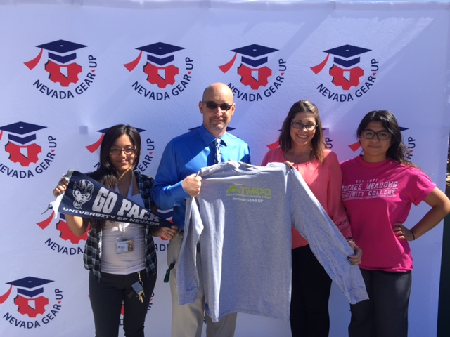 Attendees at the Nevada Gear Up week show off their UNR and TMCC spirit gear