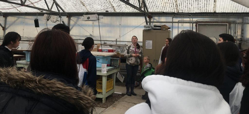 Campers attend a lecture inside a workshop