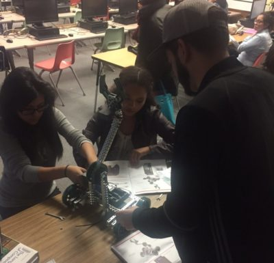 Students work together to construct a small robot