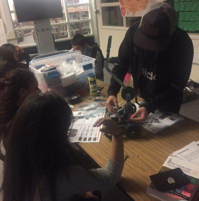 Students work on creating robots in the Hug High School robotics lab