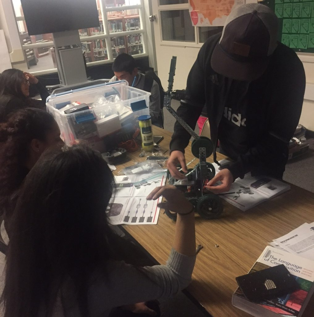 Students work on creating robots in the Hug High School robotics lab