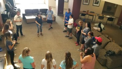Students stand in a ring to participate in icebreaker activities
