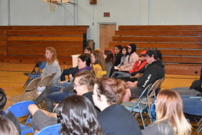 Mineral County students in folding chairs look towards the GEARUP presentation