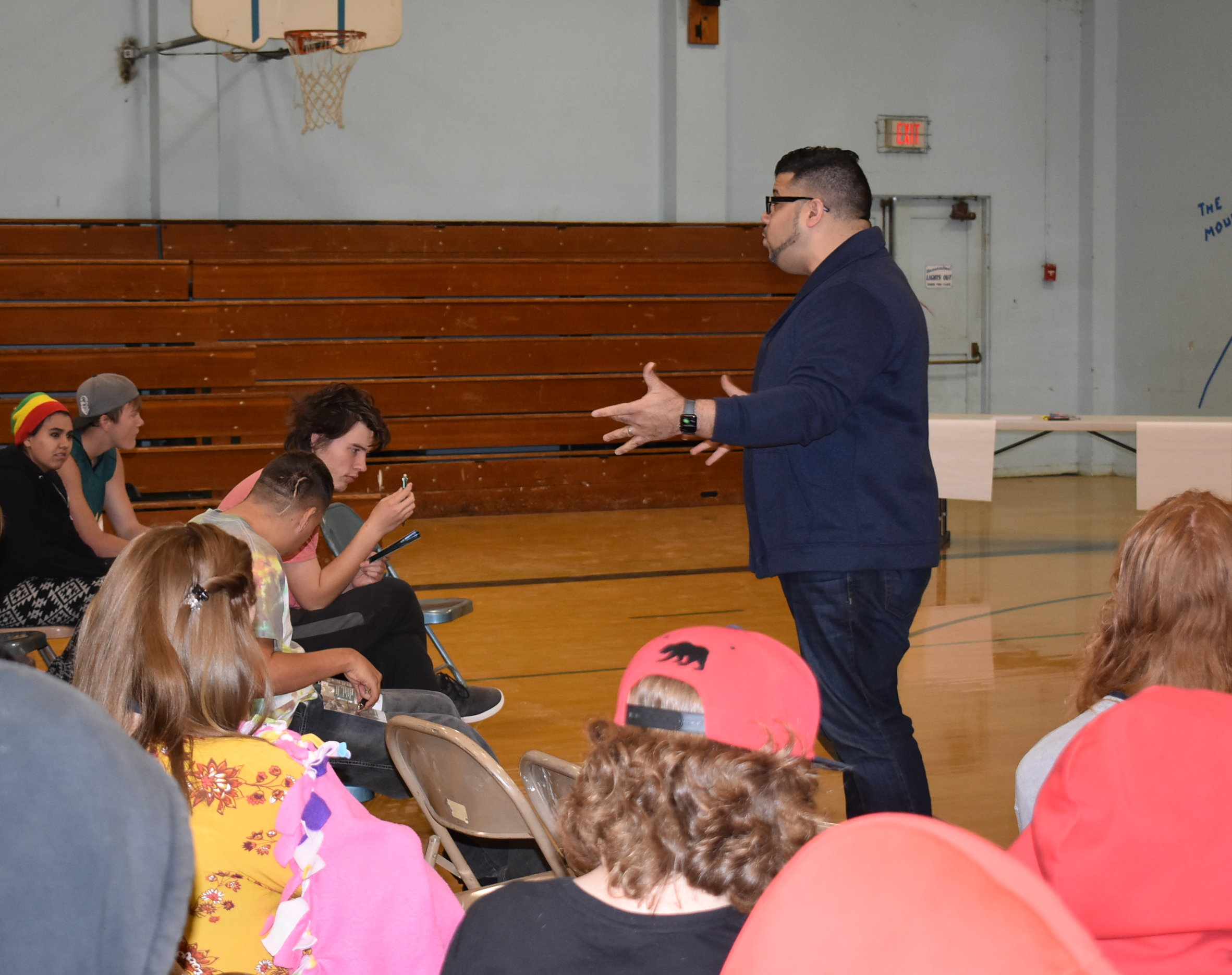 A GearUP presenter speaks to a small crowd of high school students