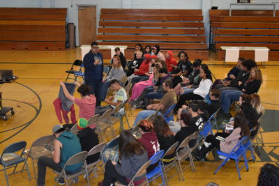 A GEARUP presenter speaks from within the crowd of students