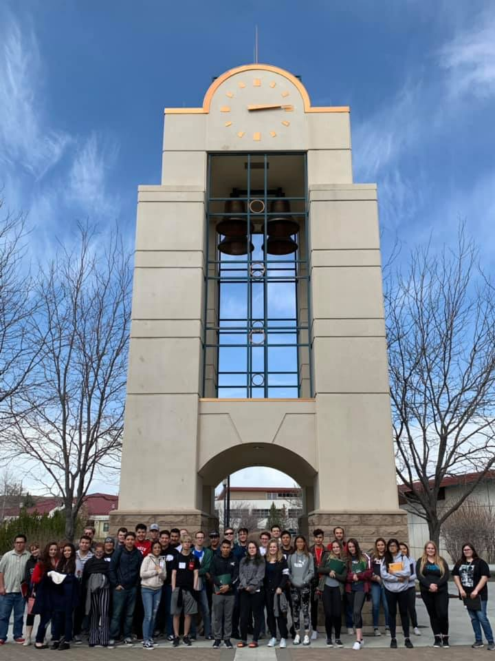 STEAM Workshop participants pose in front of the bell tower at Great Basin College
