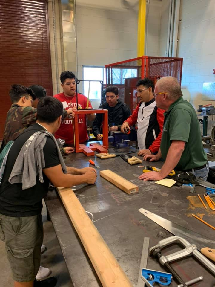 Workshop participants put their heads together to solve problems in the wood shop